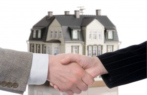 handshake arrangement buying - selling of house over white background